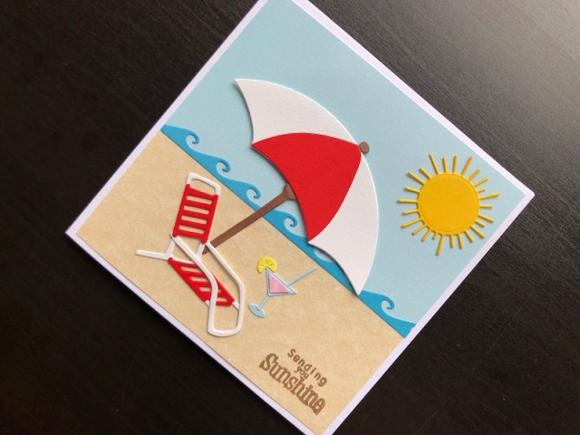 Hand made card with die cut sunshine beach scene.