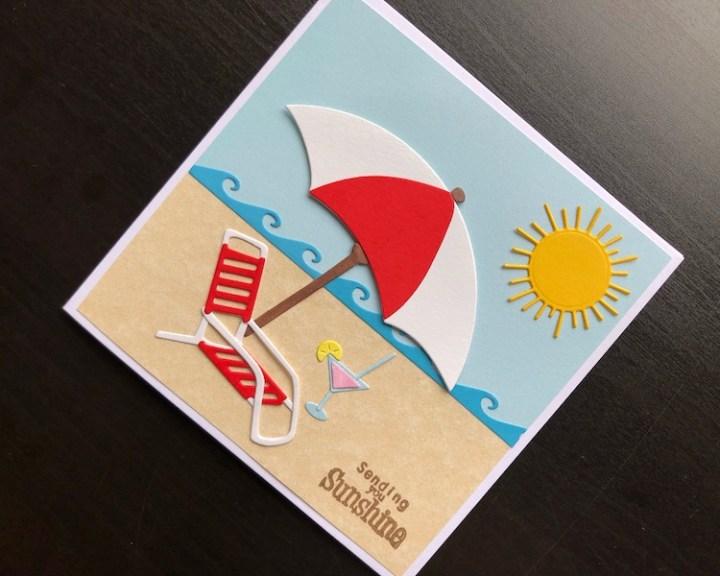 Hand made card with die cut sunshine beach scene