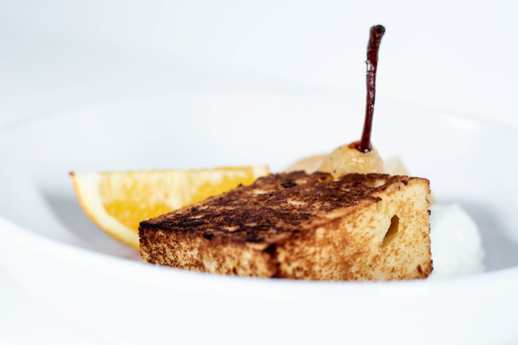 Toasted Pound cake with a wedge of orange