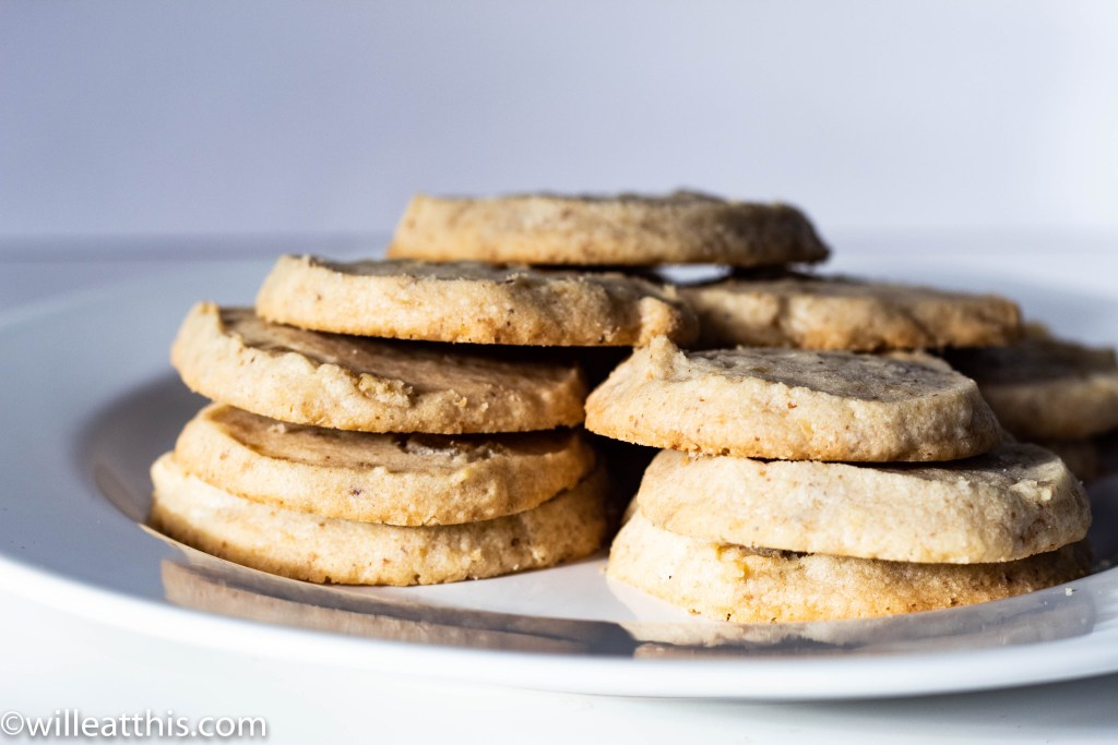 short stacks of walnut ginger shortbread on a white plate