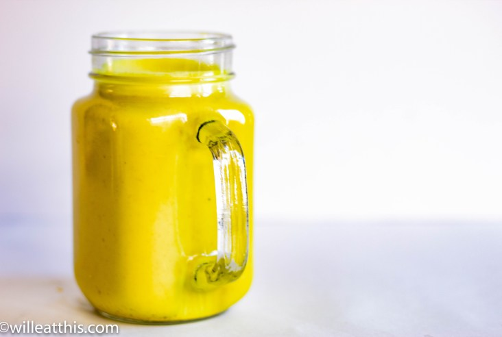 Golden Turmeric Milk in a transparent glass jar