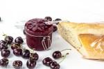 cherry rhubarb jam in jar with baguette