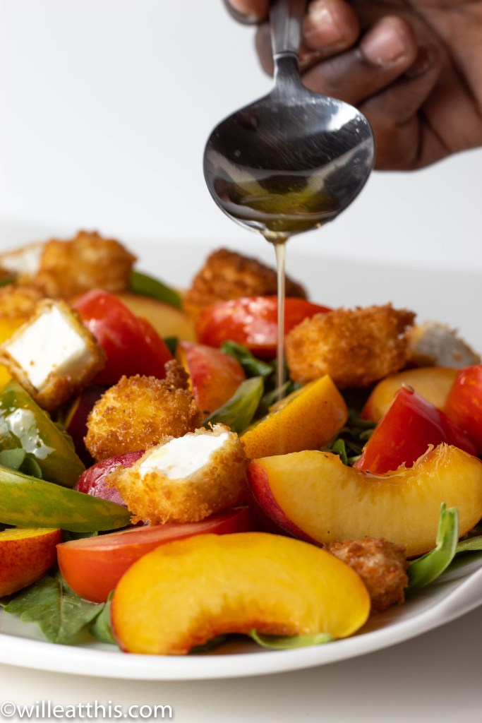 Oil Drizzle on Peach Tomato Salad with Feta Crouton