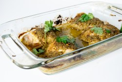 honey garlic cilantro chicken in a pyrex glass baking dish