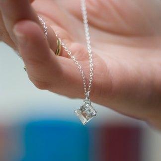 white topaz square pendant necklace in silver