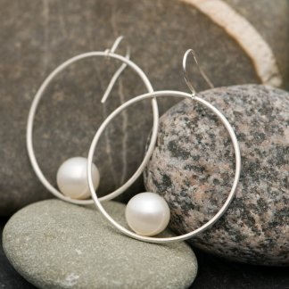 white pearl hoop earrings in silver