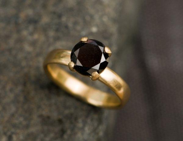 black diamond engagement ring in gold