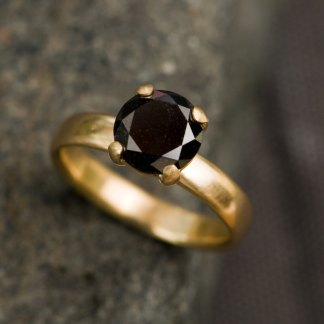 black diamond engagement ring in gold