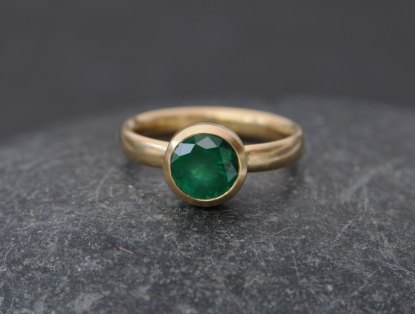 natural emerald set in yellow gold ring