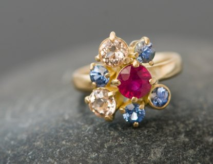Ruby cluster ring with morganites and sapphires