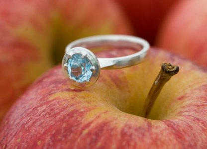 Swiss blue topaz alternative engagement ring in silver
