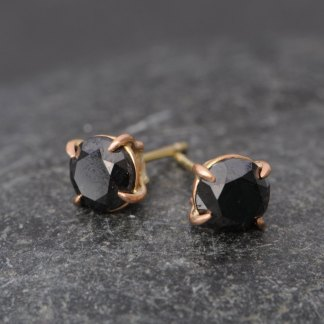 black diamond stud earrings in 18k rose gold. By William White