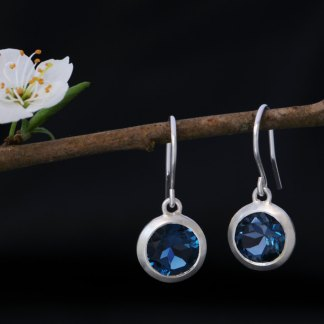 London Blue Topaz drop earrings in sterling silver. By William White