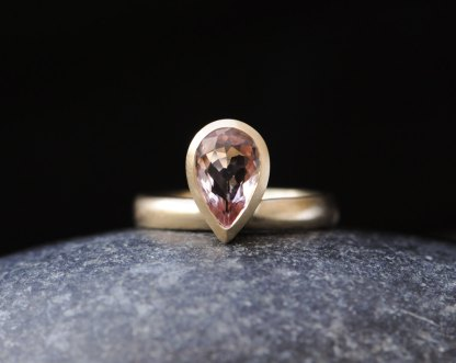 Pale pink pear cut morganite ring in gold. By William White.