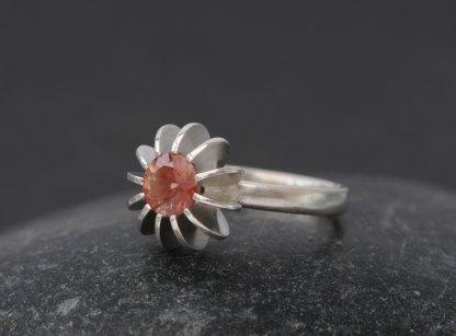 Peach sunstone set in sea urchin design silver ring