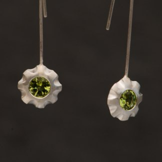 Pretty green Peridot flower dangle earrings in sterling silver. Stones are 5mm across, total earring length 50mm. Designed and handmade by William White, UK