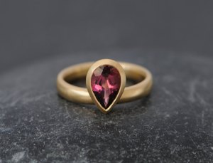 Pear cut pink tourmaline set in recycled gold ring