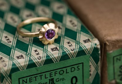Purple sapphire flower ring in gold