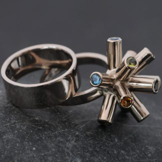 Particle Collision ring in white gold with matching wedding band