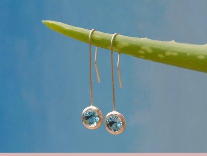 Swiss blue topaz lollipop earrings in silver. By William White