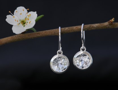 Very pretty, clean and simple white topaz drop earrings, set in satin finished sterling silver. Perfect for a wedding. Designed & handmade by William White.