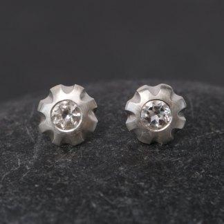 Simple White topaz flower earrings, set in sterling silver. Earrings 10mm across, stones 5mm across. Designed and handmade by William White in Cornwall, UK