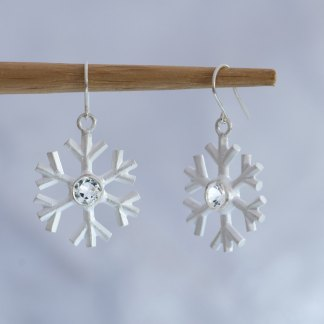 A perfect winter gift. White topaz snowflake earrings, set in sterling silver. Snowflake 20mm across, stone 5mm. Designed and handmade by William White, UK
