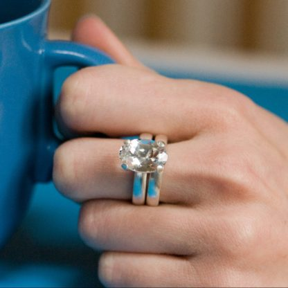 white topaz wedding set with silver wedding band and claw set topaz ring
