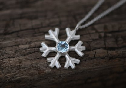Lovely and sparkly aquamarine snowflake, set in sterling silver on a fine silver necklace, by William White