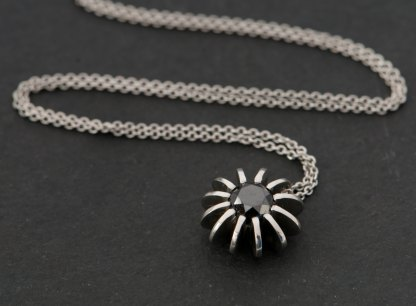 Black diamond Sea Urchin necklace, set in satin finished platinum. Diamond 6.5mm across , 1 carat. by William White