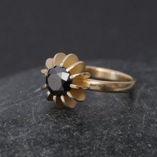 black diamond solitaire set in 18k gold sea urchin