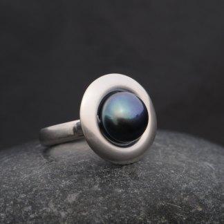 black pearl halo ring set in sterling silver
