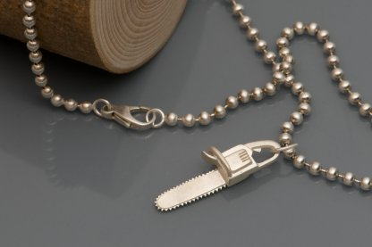 Chainsaw 'killer charm' pendant in solid silver, on a sterling silver ball chain necklace. 'Killer Charm' collection designed and handmade by William White.