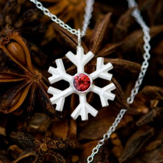 Garnet snowflake necklace, set in sterling silver on a fine silver chain. Lovely gift for a winter bride. Designed & handmade by William White in Cornwall.