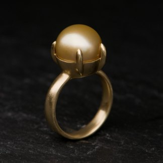 large gold pearl claw set in gold ring