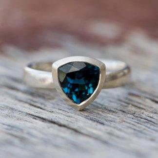 dark blue topaz trillion ring in silver