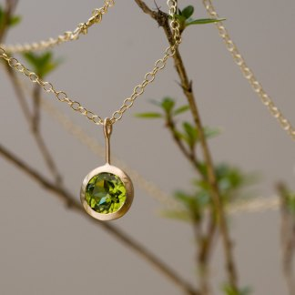 Green Peridot Lollipop necklace, set in 18k yellow gold on an 18k yellow gold chain. Designed and handmade in Cornwall, UK by William White.