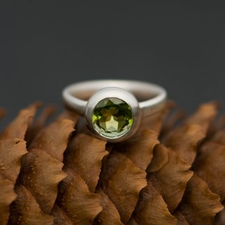 Green peridot solitaire ring in silver