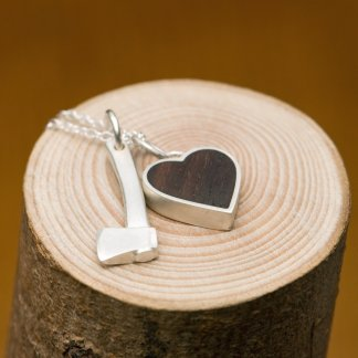 Silver hatchet 'killer charm' and silver heart set with reclaimed rose wood, on a fine silver charm necklace.