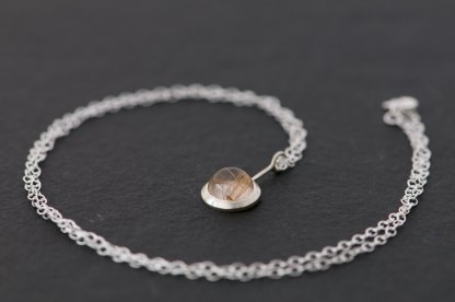Delicate Rutilated Quartz 'Lollipop' pendant necklace, set in sterling silver. A lovely necklace designed and handmade by William White in Cornwall, UK