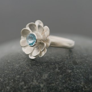 Sky blue daisy solitaire ring in silver