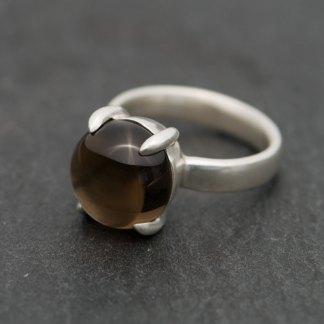 Smoky quartz cabochon claw set in silver
