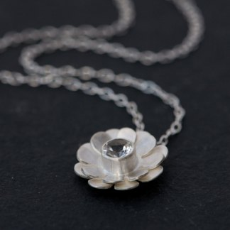 Pretty White Topaz daisy design, set in satin finished sterling silver on a silver chain. Designed and handmade by William White in Cornwall, UK.