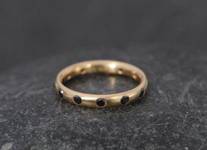 Black diamond eternity ring in gold