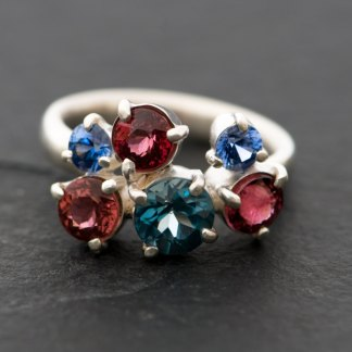 Cluster ring in silver with blue topaz, pink tourmaline and sapphire