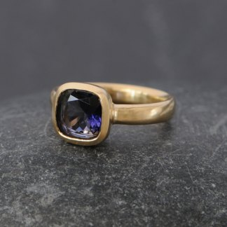 blue Iolite stone set into gold ring
