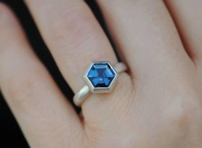 Blue topaz hexagonal stone set into silver ring