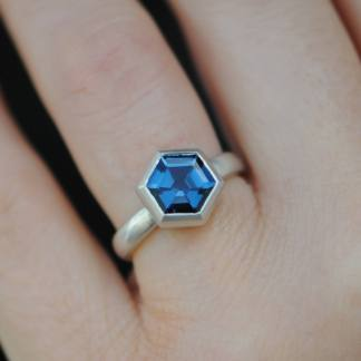 Blue topaz hexagonal stone set into silver ring