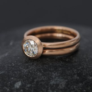 Rose Gold engagement and wedding ring with moissanite stone