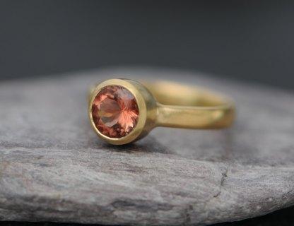 oregon sunstone solitaire set in simple gold ring design